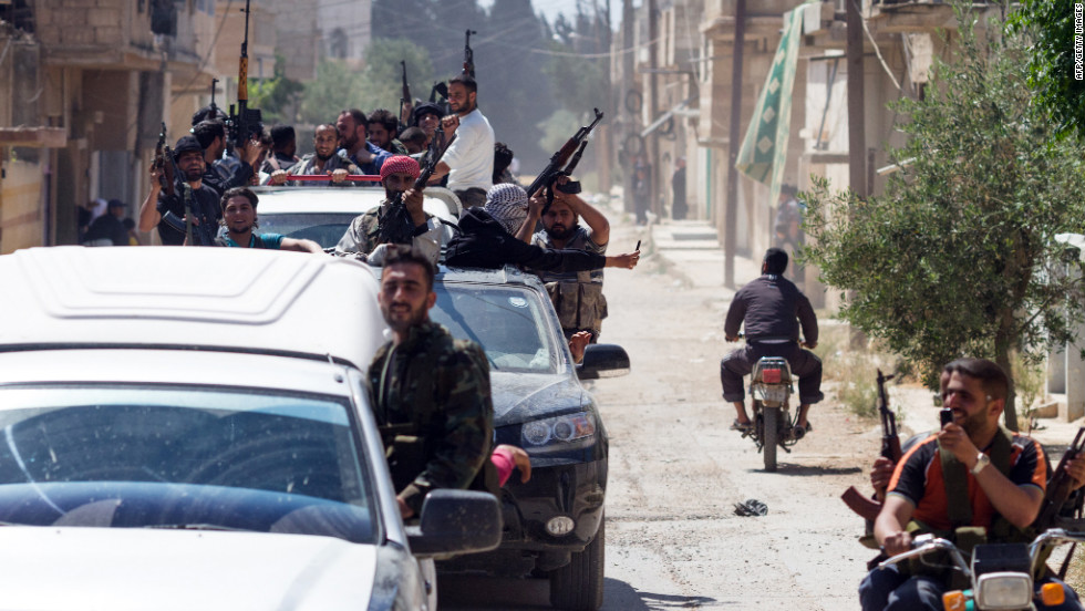 Members of the Free Syrian Army return to Qusayr on May 12, 2012 after an attack on Syrian regime forces in the village of Nizareer, near the Lebanese border in Homs.