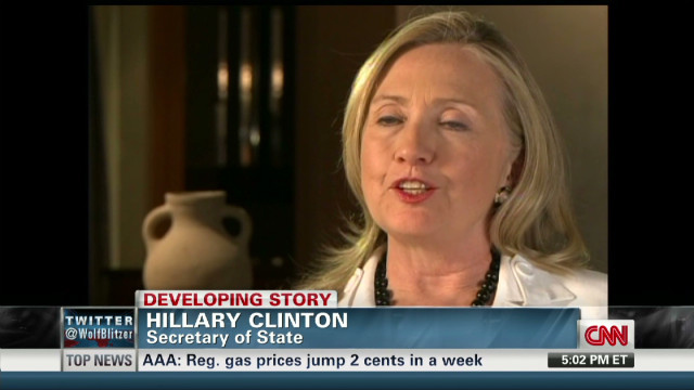 Clinton laughs about Romney Ad