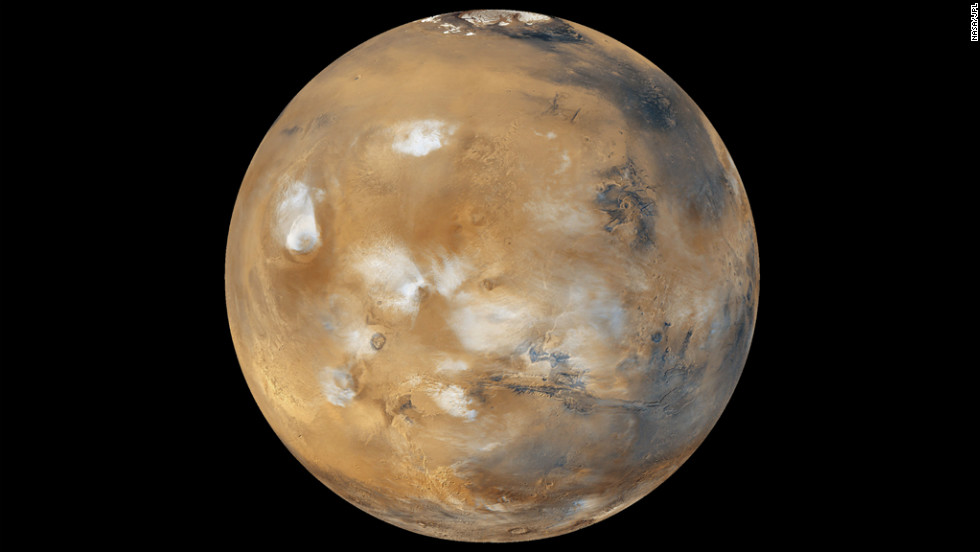 "Water-ice clouds, polar ice and other geographic features can be seen in this full-disk image of Mars from 2011. NASA's Mars Curiosity Rover touched down on the planet on August 6, 2012. Take a look at stunning photographs of Mars over the years.  <a href=""http://www.cnn.com/2012/08/14/tech/gallery/mars-curiosity-rover/index.html"" target=""_blank"">Check out images from the Mars rover Curiosity</a>."
