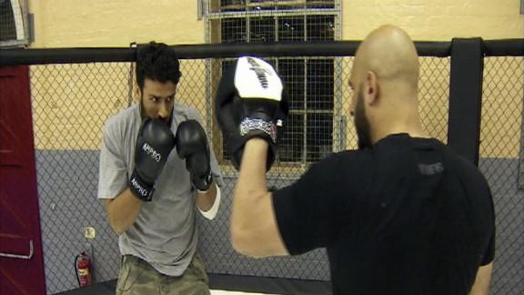 Usman Raja, (right), whose mix of martial arts and theology is deradicalizing convicted terrorists like Abu Bakr Mansha (left).