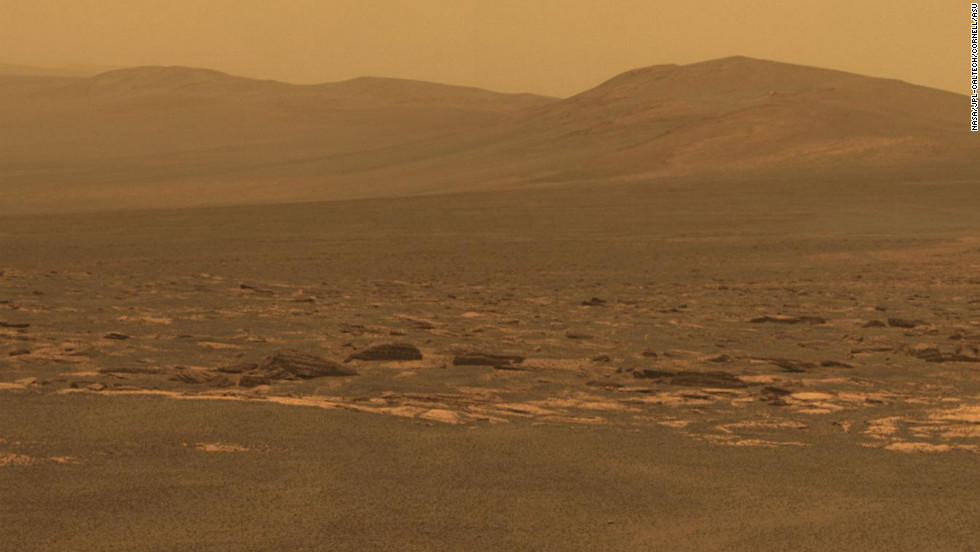A portion of the west rim of the Endeavour Crater sweeps southward in this view from NASA's Mars Exploration Rover Opportunity in 2011. The crater is 22 kilometers (13.7 miles) across.