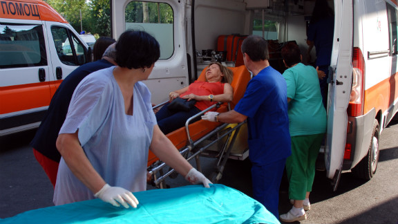 Bulgarian medics unload a wounded woman from an ambulance at a hospital.