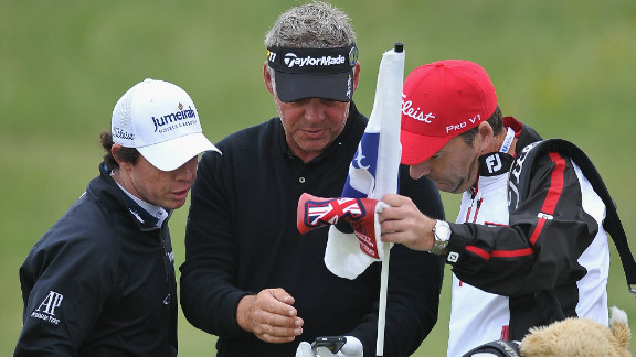 For the first time since 2006, the British Open will allow fans to bring phones onto the golf course when it gets underway on Thursday. Darren Clarke (center), who went on to lift the Claret Jug in 2011, and Rory McIlroy can be seen here checking out a phone during a practice round ahead of last year