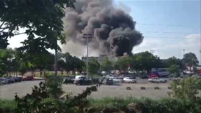 Black smoke fills sky after bus bombing