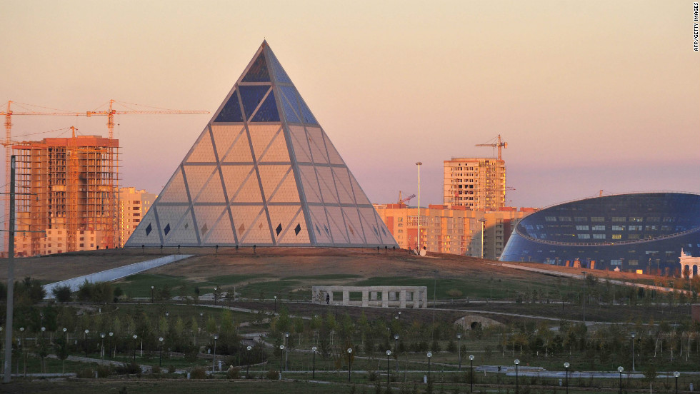As well as its Tour de France-winning team, the Kazakhstan capital's bulging, science fiction-like skyline has helped win the country international recognition. Pictured here is the Palace of Peace and Reconciliation (center) and the Shabyt Palace of Art (right).