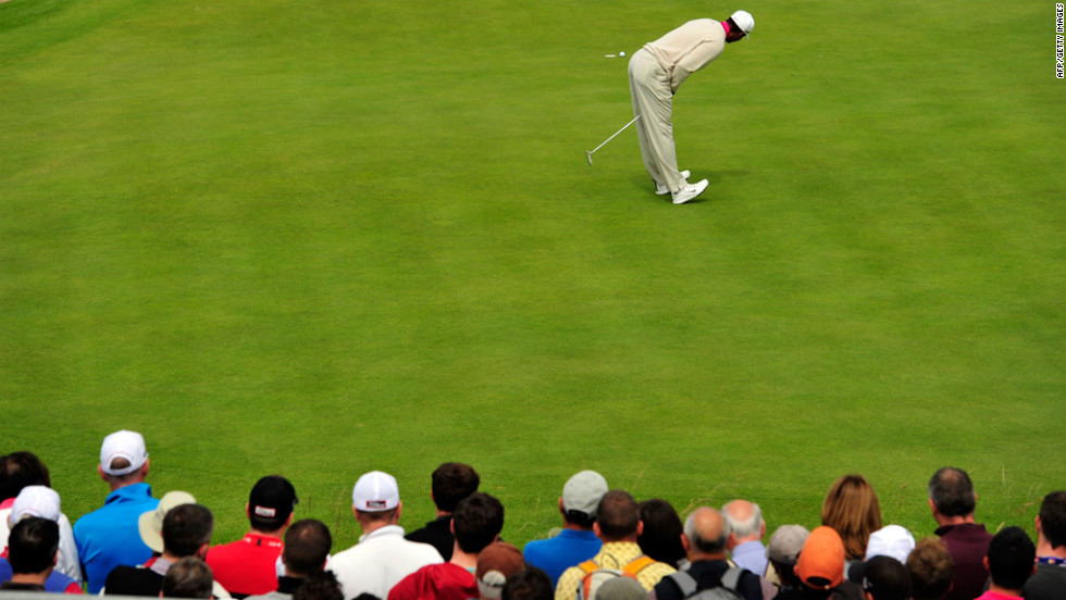 Woods reacts to missing a putt on the 13th green Thursday.