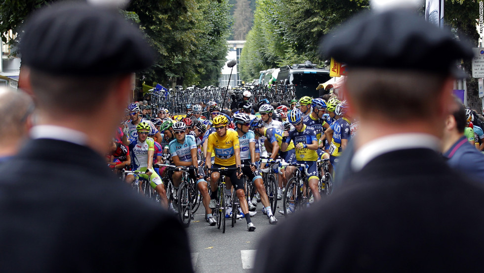 Tour de France riders wait before the start of the 17th stage of the race on Thursday.
