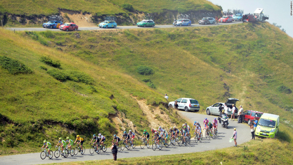 The pack of riders descends the mountainous terrain of Thursday's race.
