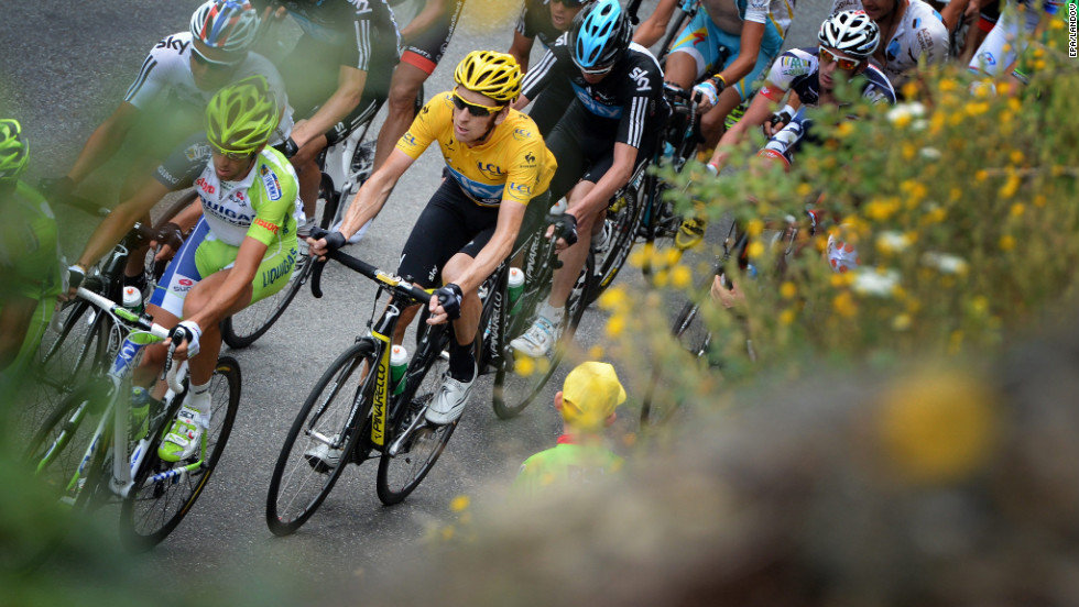 Overall race leader Bradley Wiggins of Great Britain, in yellow, rides in the main group during Thursday's race.