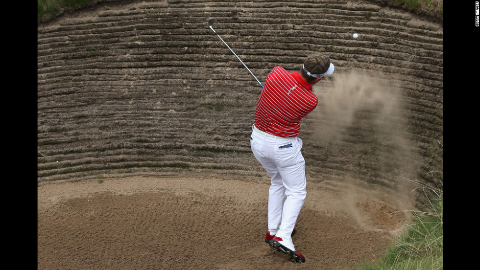 Luke Donald of England hits his third shot on the seventh hole during the first round Thursday.