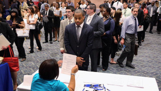 Job applicants line up to meet potential employers at a job fair on June 11, 2012, in New York City.