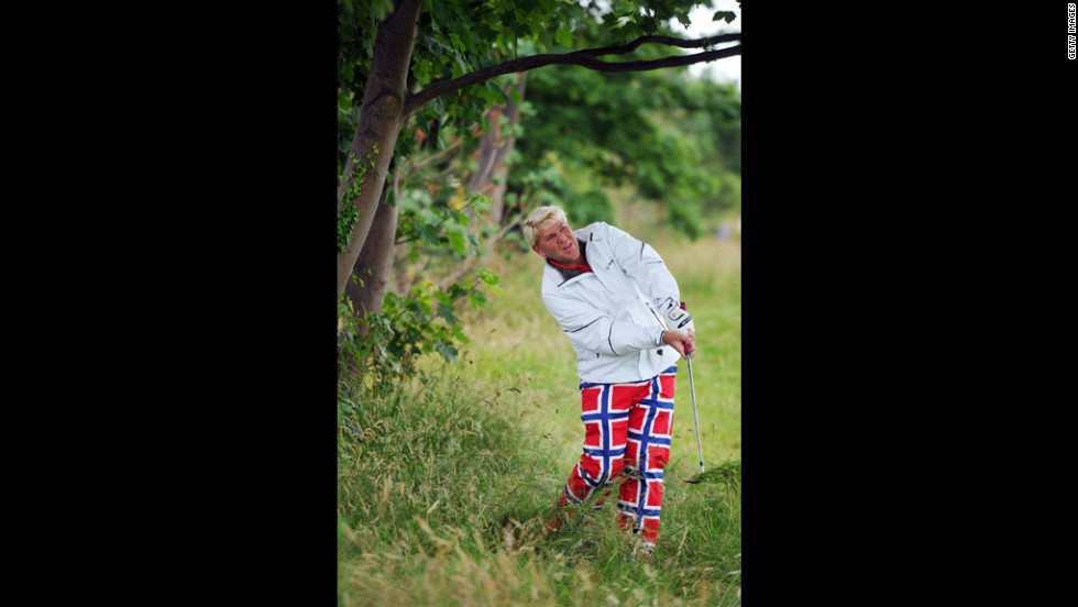John Daly of the United States attempts a shot from well off the fairway on the second hole Thursday.