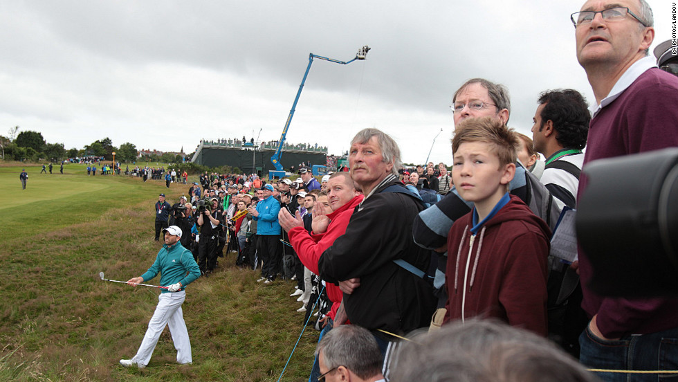 Spectators lean in to follow a shot out of the rough from Garcia on Thursday.