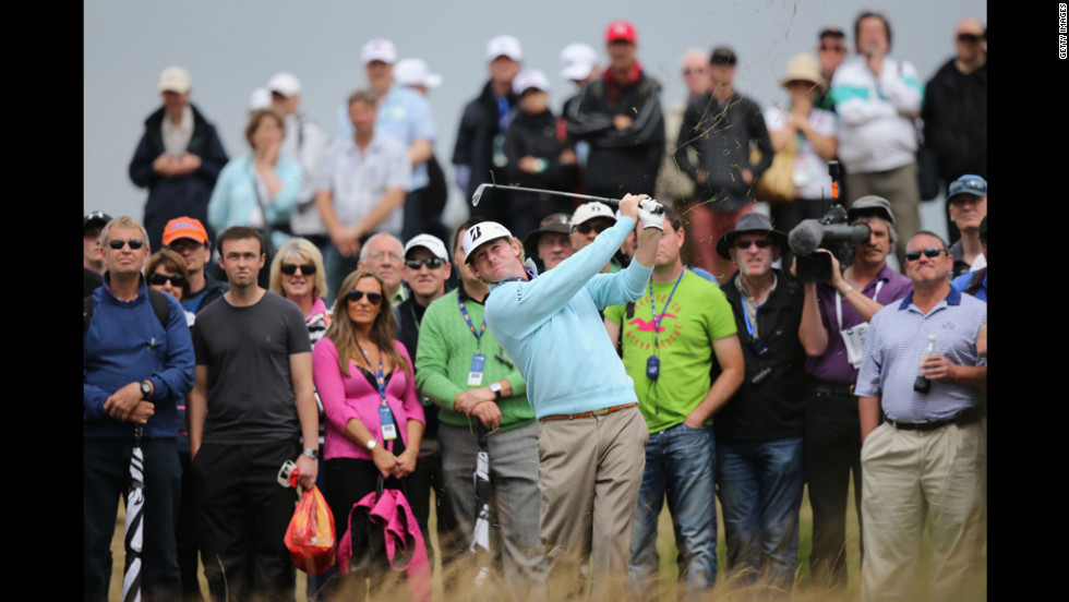 Spectators follow the flight of Snedeker's ball after a shot from the rough during the second round of the British Open on Friday, July 20