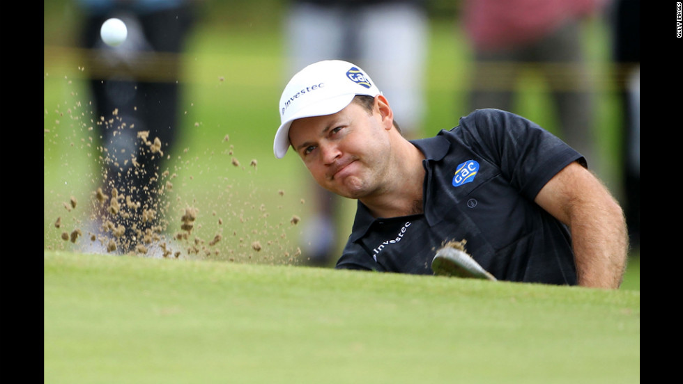 Richard Sterne of South Africa hits from a greenside bunker on the 11th hole during the second round Friday.