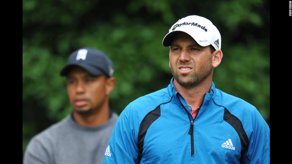 Sergio Garcia of Spain and Tiger Woods of the United States look on at the first tee during the second round Friday.