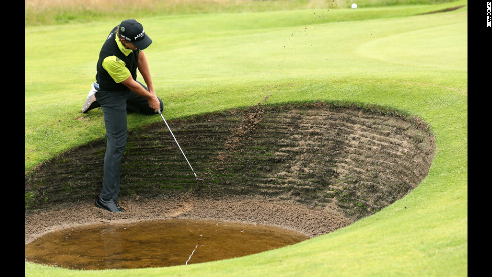 Aaron Baddeley of Australia plays a bunker shot on the fourth hole during the second round Friday.