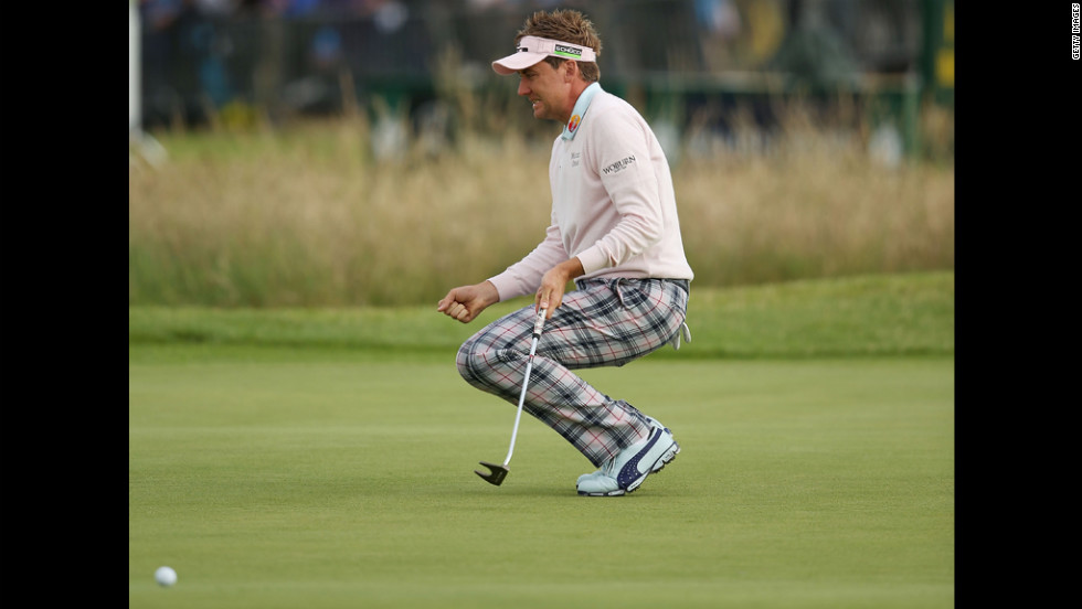 Ian Poulter of England reacts after missing a birdie putt on the 13th green Friday.