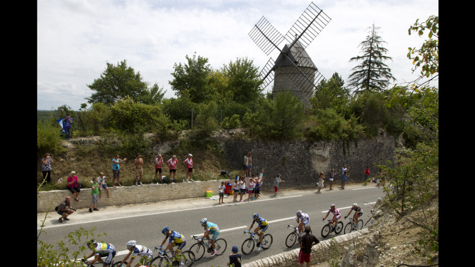 Fans cheer on the pack riding past a windmill on Friday.