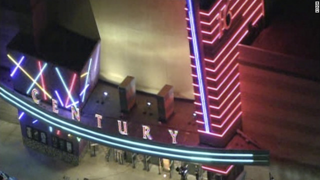 "A gunman opened fire early today at a screening of the new Batman movie in an Aurora, Colorado, theater. ""We saw people running around and screaming,"" a man told CNN affiliate KUSA. A suspect is in custody, police say."