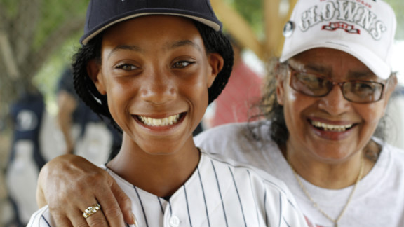 """Along their cross-country journey, Philadelphia's Anderson Monarchs played games against local youth teams, visited historic sites and met surviving Negro League players. Here, Mamie """"Peanut"""" Johnson, right, the only female pitcher in the Negro Leagues, meets her 21st century counterpart, Mo'ne Davis, 11."""