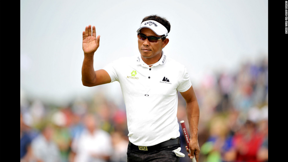Golfer Thongchai Jaidee of Thailand waves to the gallery after making a putt on Saturday.