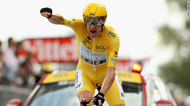 Sky's Bradley Wiggins punches the air as he crosses the finish line in first place on Saturday