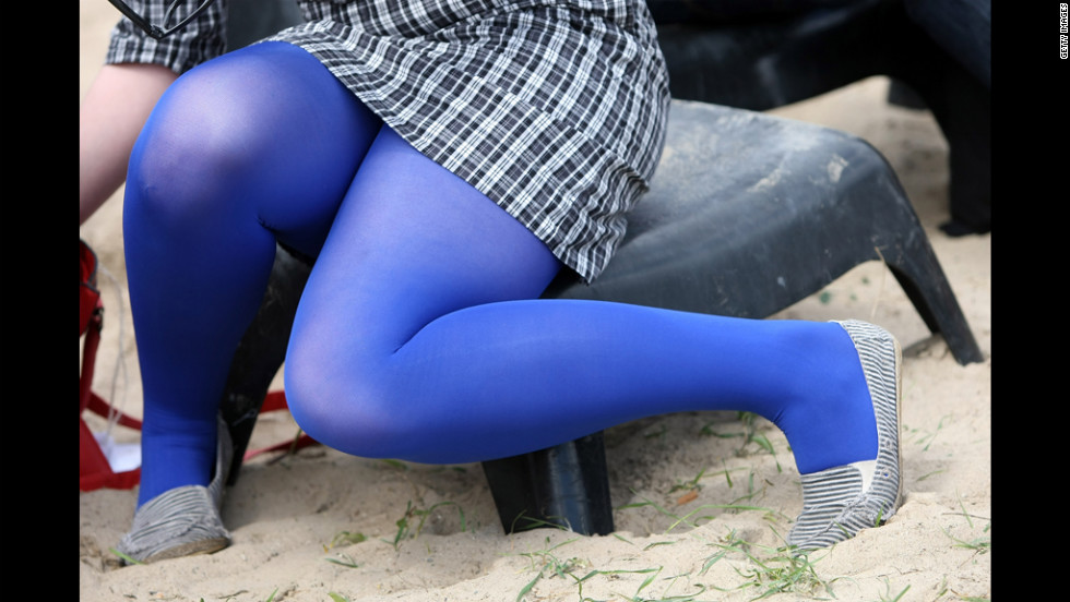 A girl wearing blue tights sits down during the matches.