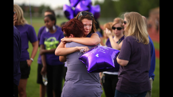 Family, friends and former classmates of movie theater shooting victim A.J. Boik gather for a memorial service at Gateway High School on Saturday.