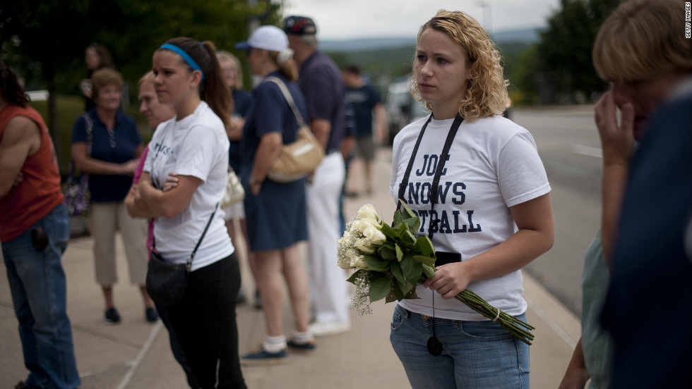 Fans like Rachel O'Brien, center, 20, of Mifflinburg, Pennsylvania, have been steadily flocking to the site since Paterno's death in January.
