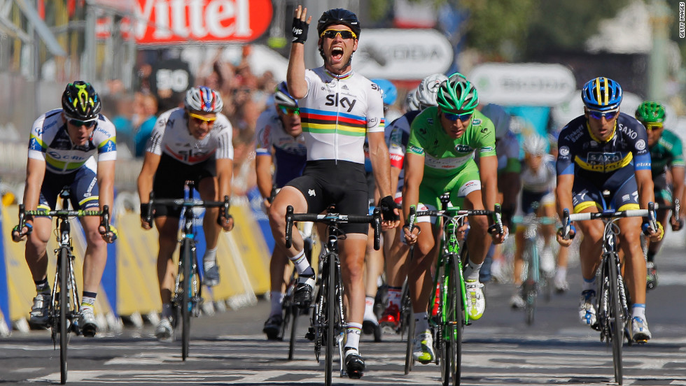 Mark Cavendish of Great Britain celebrates as he crosses the finish line to win the bunch sprint during the 20th and final stage of the Tour de France.