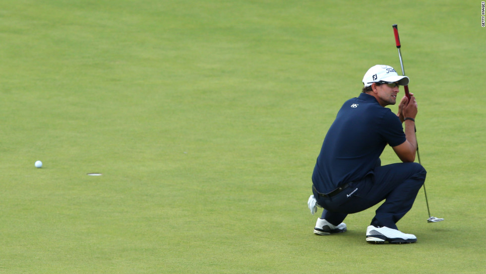 Adam Scott of Australia reacts to a missed par putt on the 18th green Sunday.