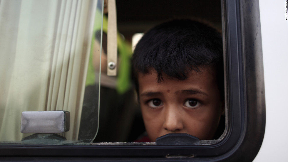 On Sunday, July 22, a Syrian refugee looks out from a bus as he arrives at a refugee camp in Turkey opposite the Syrian commercial crossing point Bab al-Hawa.