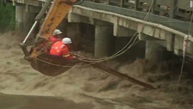 Workers battle floods to rescue man