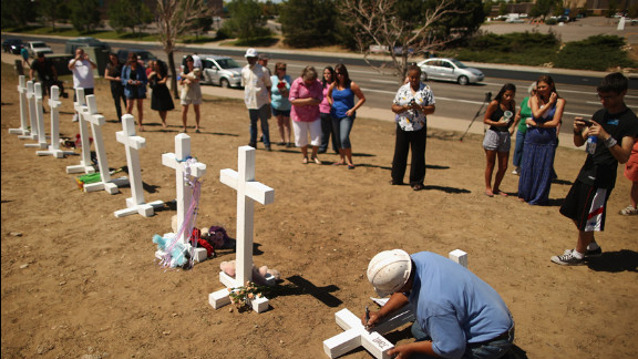 Greg Zanis writes the names of the victims of last weekend