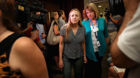 Family members of the victims arrive at the courthouse July 23, 2012, for the suspect's first court appearance.
