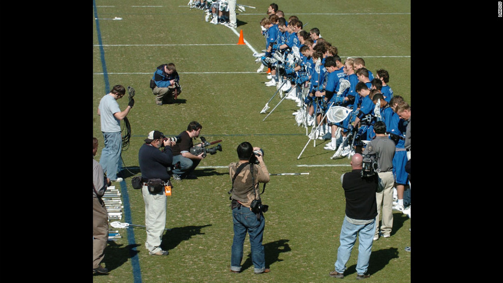 Members of the Duke men's lacrosse team listen to the national anthem at their season opener in 2007. In 2006, members of the team hired stripper Crystal Mangum for a party, and she accused three players of raping her. The scandal forced the cancellation of the men's lacrosse season that year and the resignation of team coach Mike Pressler. The allegations later proved to be false, and prosecutor Mike Nifong was disbarred for ethics violations.
