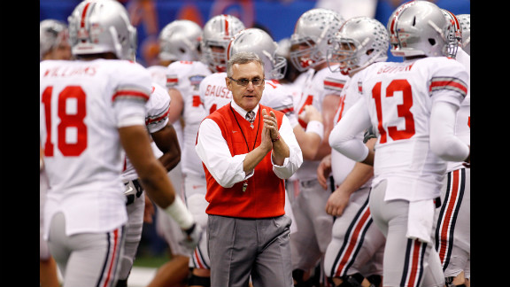 "Head coach Jim Tressel with his Ohio State Buckeyes at the 2011 Sugar Bowl. Tressel admitted he knew several star players were trading memorabilia for cash and tattoos in violation of NCAA rules. The NCAA banned the Buckeyes from postseason play for the upcoming season, and OSU voluntarily vacated all 2010 wins. Tressel ""resigned"" in May 2011, a move OSU later deemed a retirement."