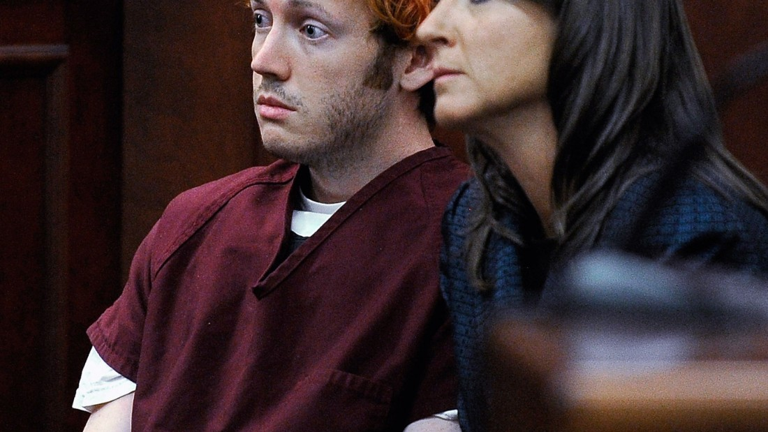 "CENTENNIAL, CO - JULY 23:  James Holmes (L) makes his first court appearance at the Arapahoe County Courthouse with his public defender Tamara Brady on July 23, 2012 in Centennial, Colorado. According to police, Holmes killed 12 people and injured 58 others during a shooting rampage at an opening night screening of ""The Dark Knight Rises"" July 20, in Aurora, Colorado.  (Photo by RJ Sangosti-Pool/Getty Images)"