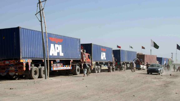 NATO supply trucks drive toward the border terminal in Chaman on July 17, 2012.