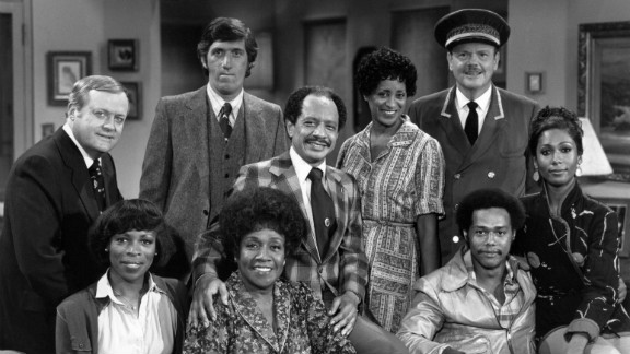 """""""The Jeffersons"""": (Back row, from left) Franklin Cover, Paul Benedict, Sherman Hemsley, Marla Gibbs and Ned Wertimer. (Front row, from left) Roxie Roker, Isabel Sanford, Mike Evans and Berlinda Tolbert."""