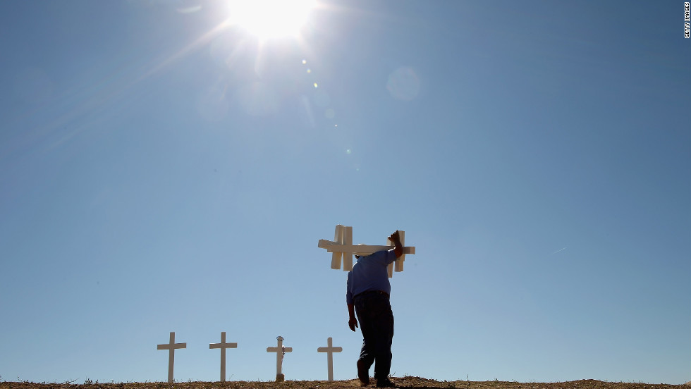 Man builds crosses for shooting victims