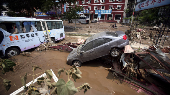 Weekend flooding leaves vehicles tossed about on roads in Laishui, a town in northern China