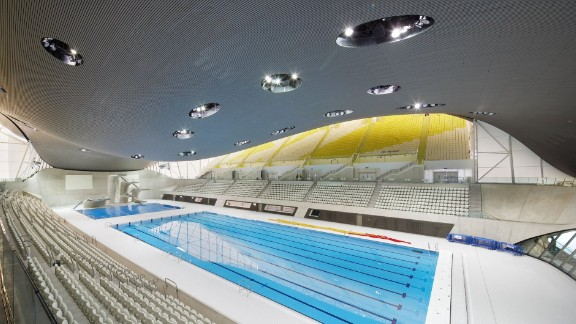 """Inspired by the fluid geometry of water in motion, Zaha Hadid's London Aquatic Centre is considered the """"most majestic"""" Olympic space."""