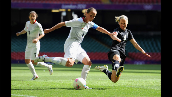 Casey Stoney of Great Britain goes up against Katie Hoyle of New Zealand.
