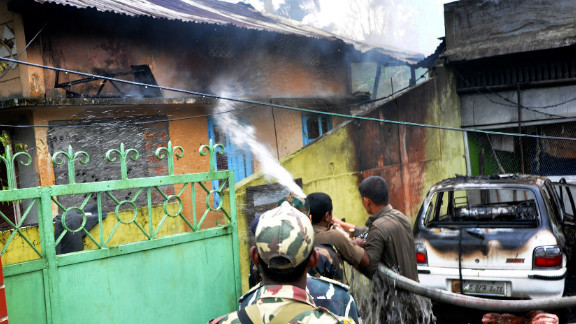 Firefighters put out a fire in a house set alight by rioters in Kokrajhar district in the northeastern state of Assam, India, Tuesday.