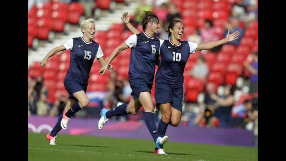 American Carli Lloyd celebrates with teammate Amy Le Peilbet after scoring her team