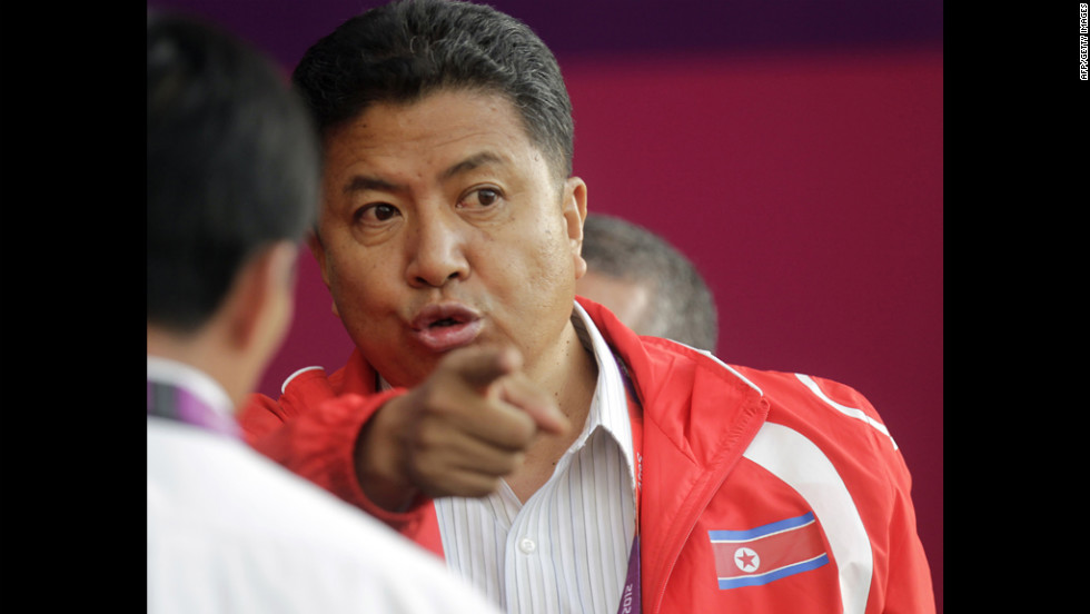 North Korean official Son Kwang-ho waits for the match against Colombia to begin.