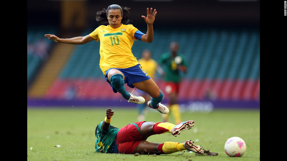 Brazil's Marta, No. 10, is tackled by Christine Manie of Cameroon during the first-round women's soccer match on July 25.