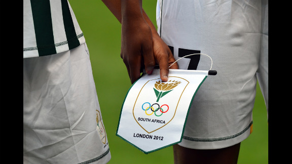 South African footballers hold a pennant as they line up before their first-round women